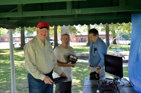 Dave Perry, Ed Pflueger and Fred Nichols set up the CW station.