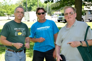 Bruce Huyck, Garry Wheatley and Ken Wontor pause during antenna work.